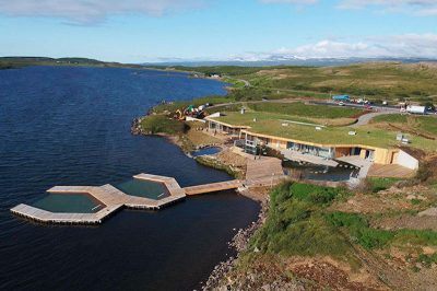 New geothermal bath featuring pools floating at lake shore in Iceland
