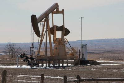 How could geothermal energy be derived from oil wells?